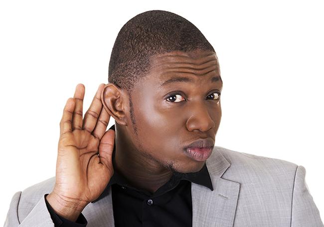 Handsome black african man overhears